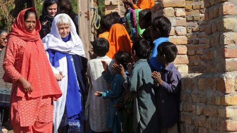Ruth Pfau is welcomed by brick kiln laborers in Karachi in 2010.