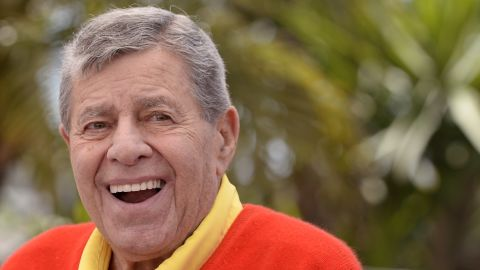 """US comedian Jerry Lewis poses on May 23, 2013 during a photocall for the film """"Max Rose"""" presented Out of Competition at the 66th edition of the Cannes Film Festival in Cannes. Cannes, one of the world's top film festivals, opened on May 15 and will climax on May 26 with awards selected by a jury headed this year by Hollywood legend Steven Spielberg.       AFP PHOTO / ANNE-CHRISTINE POUJOULAT        (Photo credit should read ANNE-CHRISTINE POUJOULAT/AFP/Getty Images)"""