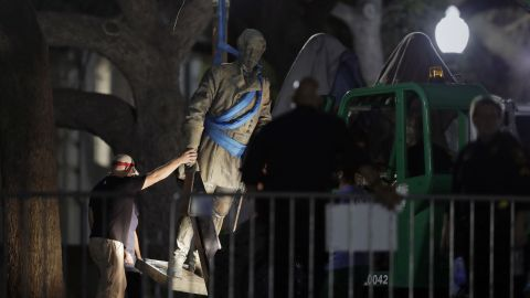 """A statue of Confederate Gen. Robert E. Lee is removed from the University of Texas campus, early Monday morning, Aug. 21, 2017, in Austin, Texas. University of Texas President Greg Fenves ordered the immediate removal of statues of Robert E. Lee and other prominent Confederate figures from a main area of campus, saying such monuments have become """"symbols of modern white supremacy and neo-Nazism."""""""
