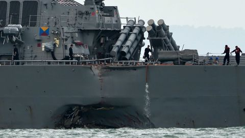 The guided-missile destroyer USS John S. McCain is seen with a hole on its portside after a collision with an oil tanker outside Changi naval base in Singapore on August 21, 2017. Ten US sailors were missing and five injured after their destroyer collided with a tanker east of Singapore early on August 21, the second accident involving an American warship in two months. / AFP PHOTO / Roslan RAHMAN        (Photo credit should read ROSLAN RAHMAN/AFP/Getty Images)