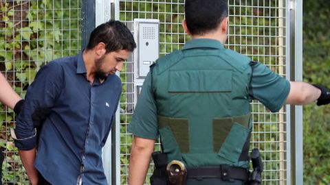 Salah el Karib, one of four suspects arrested in the  attacks, is escorted into court Tuesday in Madrid.