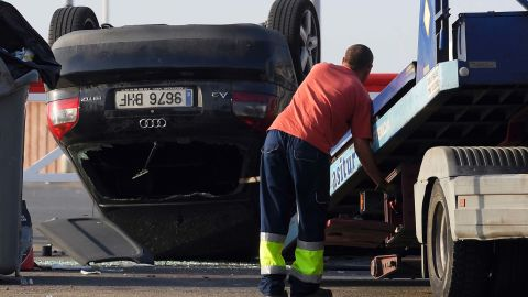 An employee starts to tow away a car involved in a terrorist attack in Cambrils, south of Barcelona.