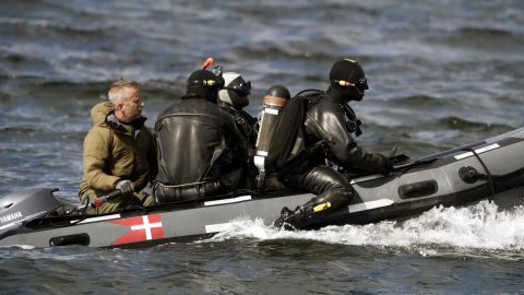 Divers from the Danish Defence Command are seen preparing for a dive near Amager in Copenhagen on Tuesday.