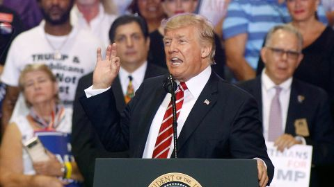 PHOENIX, AZ - AUGUST 22:  U.S. President Donald Trump speaks to a crowd of supporters at the Phoenix Convention Center during a rally on August 22, 2017 in Phoenix, Arizona. An earlier statement by the president that he was considering a pardon for Joe Arpaio,, the former sheriff of Maricopa County who was convicted of criminal contempt of court for defying a court order in a case involving racial profiling, has angered Latinos and immigrant rights advocates.  (Photo by Ralph Freso/Getty Images)