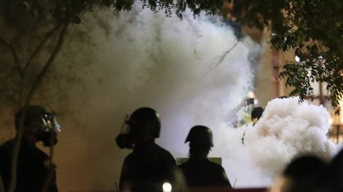 Smoke billows after Phoenix police used tear gas outside the Phoenix Convention Center, Tuesday, Aug. 22, 2017, in Phoenix. Protests were held against President Donald Trump as he hosted a rally inside the convention center. (AP Photo/Matt York)
