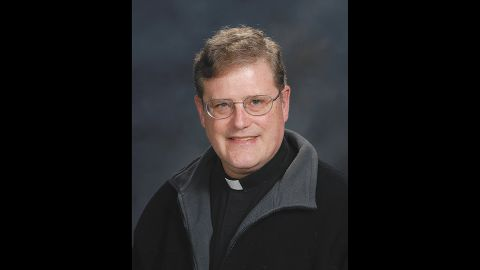 The Rev. William Aitcheson, a Catholic priest, has voluntarily stepped down from public ministry after news came out about him being a KKK member 40 years ago.