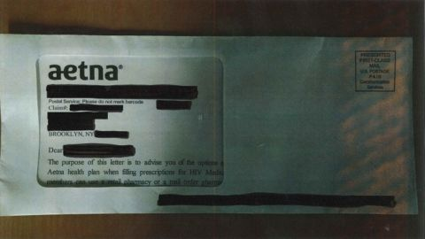 A photo of the Aetna letter seen through an envelope's window.