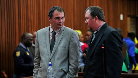 Theo Jackson and Willem Oosthuizen seen during an appearance in court on charges of assault and attempted murder of Victor Mlotshwa on August 21, 2017.