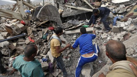 Yemenis search under the rubble of a house destroyed in Friday's airstrike.