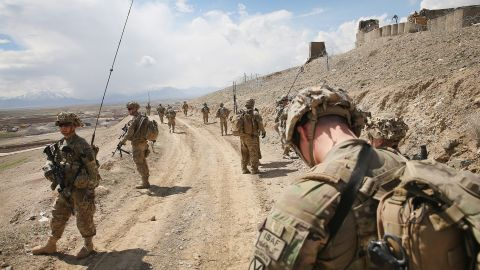 PUL-E ALAM, AFGHANISTAN - MARCH 29:  Soldiers with the U.S. Army's 2nd Battalion 87th Infantry Regiment, 3rd Brigade Combat Team, 10th Mountain Division patrol on the edge of a village outside of Forward Operating Base (FOB) Shank on March 29, 2014 near Pul-e Alam, Afghanistan. The primary mission of soldiers with the 10th Mountain Division stationed at FOB Shank is to advise and assist Afghan National Security Forces in the region. The soldiers continue to patrol outside the FOB in an effort to decrease rocket attacks on the FOB from the nearby villages.  Security is at a heightened state throughout Afghanistan as the nation prepares for the April 5th presidential election.  (Photo by Scott Olson/Getty Images)