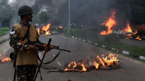 An Indian soldier stands guard Friday in Panchkula, where the guru's trial was held.