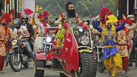 """FILE- In this Wednesday, Oct. 5, file 2016 photo, Indian spiritual guru, who calls himself Saint Dr. Gurmeet Ram Rahim Singh Ji Insan, arrives for a press conference ahead of the release of his new film """"MSG, The Warrior Lion Heart,"""" in New Delhi, India. Several cities in north India were under a security lock down Thursday ahead of a verdict in a rape trial involving the controversial and hugely popular spiritual leader. (AP Photo/Tsering Topgyal, File)"""