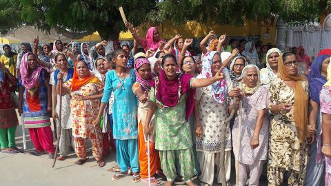 The guru's supporters gather on the roadside in Sirsa on Thursday before the verdict in the rape case.