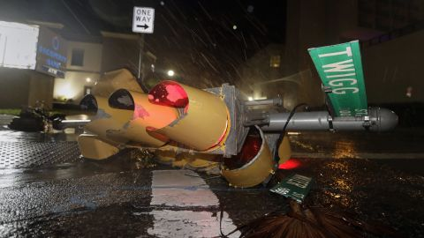 A downed traffic signal lies in a street in Corpus Christi, Texas, on August 26.