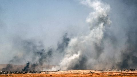 Smoke billows as Iraqi forces, backed by Popular Mobilization Units, advance inside the town of Tal Afar on Friday, August 25.