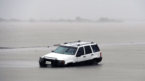 A car is stranded in floodwaters on August 26 after Hurricane Harvey hit Corpus Christi, Texas.