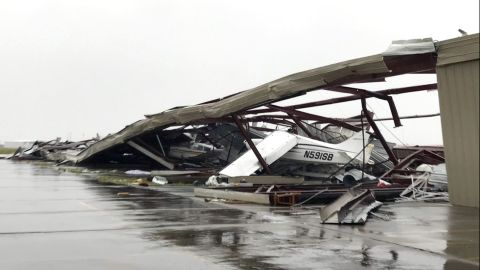 A small plane sits damaged in a destroyed hangar August 26 after Hurricane Harvey hit Rockport.
