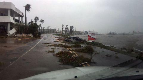 Damage and debris strewn along the shoreline Saturday in Rockport, Texas.