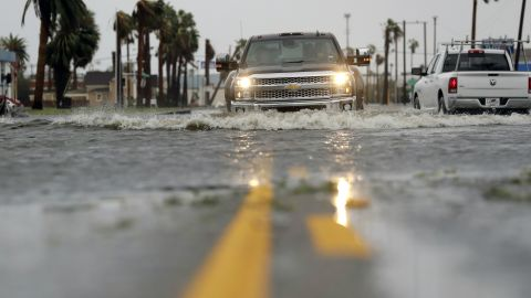 A drives moves through flood waters left behind by Hurricane Harvey, Saturday, August 26, 2017, in Aransas Pass, Texas. Harvey rolled over the Texas Gulf Coast on Saturday, smashing homes and businesses and lashing the shore with wind and rain so intense that drivers were forced off the road because they could not see in front of them. (