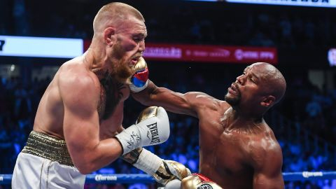 Nevada , United States - 26 August 2017; Floyd Mayweather Jr, right, and Conor McGregor during their super welterweight boxing match at T-Mobile Arena in Las Vegas, USA. (Photo By Stephen McCarthy/Sportsfile via Getty Images)