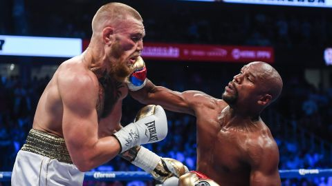 """Floyd Mayweather Jr. lands a right hand against Conor McGregor during their boxing match in Las Vegas on Saturday, August 26. Mayweather <a href=""""http://www.cnn.com/2017/08/27/sport/mayweather-vs-mcgregor-fight/index.html"""" target=""""_blank"""">stopped McGregor in the 10th round,</a> collecting his 50th victory in what he said will be the last fight of his undefeated pro career. It was the first pro boxing match for McGregor, a mixed martial artist who is the UFC's lightweight champion."""