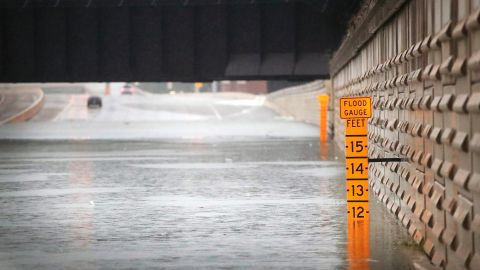 A flood guage in an underpass warns of the water's depth on Interstate 10 in Houston on Sunday.