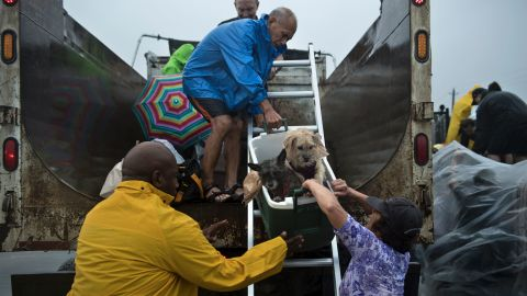 Evacuees are loaded onto a truck in Houston.