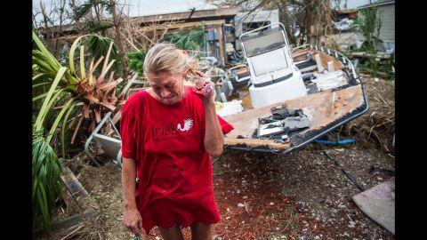 Melani Zurawski cries while inspecting her home in Port Aransas, Texas.
