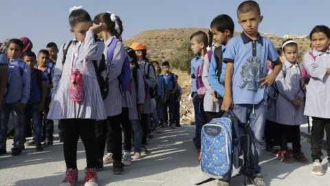 Children standing in the line , Jana is the first on the left, crying