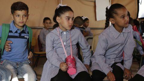 Jana Zawahra (c) attends class in a tent after her school was demolished in Jub El-Thib.
