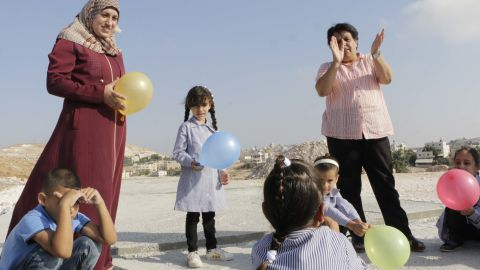 Second graders take part in a balloon activity outside the makeshift classroom.