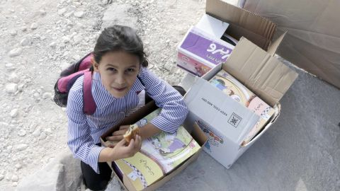 Ibtisam, a 6-year-old student, said she was excited to get her books for the new school year.