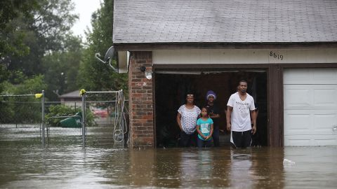 People wait to be rescued from their flooded home in Houston.