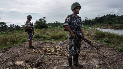 Border police standing guard at Tinmay village, Buthidaung township in Myanmar's northern Rakhine state.