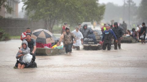 HOUSTON, TX - AUGUST 28:  People are rescued from a flooded neighborhood after it was inundated with rain water, remnants of Hurricane Harvey, on August 28, 2017 in Houston, Texas. Harvey, which made landfall north of Corpus Christi late Friday evening, is expected to dump upwards to 40 inches of rain in areas of Texas over the next couple of days.  (Photo by Scott Olson/Getty Images