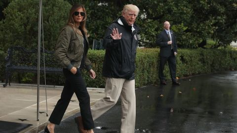 WASHINGTON, DC: U.S. President Donald Trump walks with first lady Melania Trump prior to their Marine One departure from the White House August 29, 2017 in Washington, DC. President Trump was traveling to Texas to observe the Hurricane Harvey relief efforts. (Alex Wong/Getty Images)