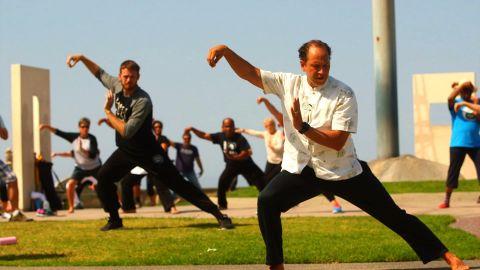 Daniel Hoover teaches a free tai chi class on a hilltop in Long Beach, California.