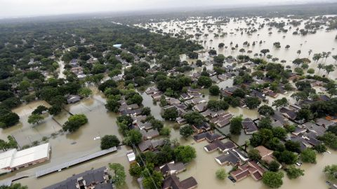 Water from the Addicks Reservoir in Houston flows into neighborhoods as floodwaters rise on Tuesday, August 29.