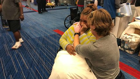 Harvey evacuee Karen Preston cries after being given a blanket and pillow at the Houston convention center.