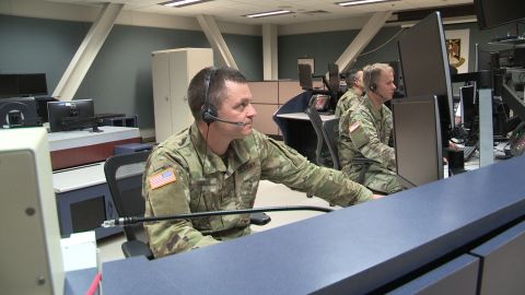 National Guard soldiers participate in a drill inside the Fire Direction Center. The name tag of one of the officers pictured here has been obscured for security reasons.