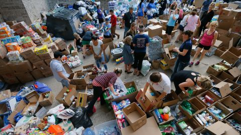 Volunteers in Dallas organize items donated for hurricane victims.