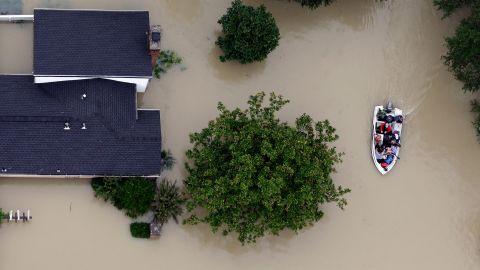 Residents evacuate their homes near the Addicks Reservoir in Houston on August 29.
