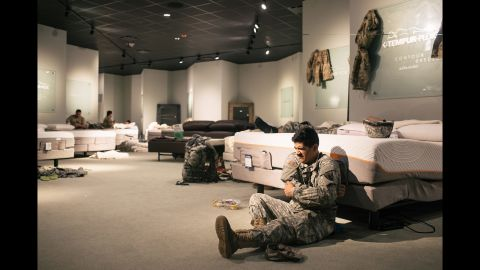 Members of the National Guard rest at a furniture store in Richmond, Texas.
