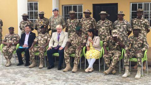 UK foreign secretary Boris Johnson and international development secretary Priti Patel with Nigerian forces on Wednesday.