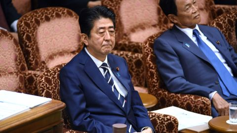 Japan's Prime Minister Shinzo Abe (left) and Deputy Prime Minister Taro Aso (right) attend a budget dommittee meeting in parliament on July 25.