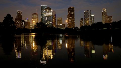 Downtown Houston is reflected in the flooded Buffalo Bayou on Wednesday, August 30.