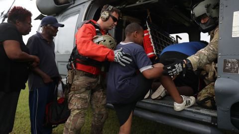 Tthe Florida Air Force Reserve Para-Rescue team from the 308th Rescue Squadron helps evacuees board a helicopter in Port Arthur on August 30.