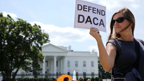 About 20 protesters demonstrate to demand immigration reform in front of the White House August 30, 2017, in Washington, DC.