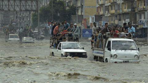 Pakistani commuters travel on a flooded street following a heavy rainfall in Karachi, Pakistan, Thursday, Aug. 31, 2017.