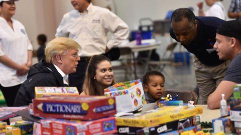 President Donald Trump, with Secretary of Housing and Urban Development Ben Carson, visits Hurricane Harvey victims at NRG Center in Houston on September 2.